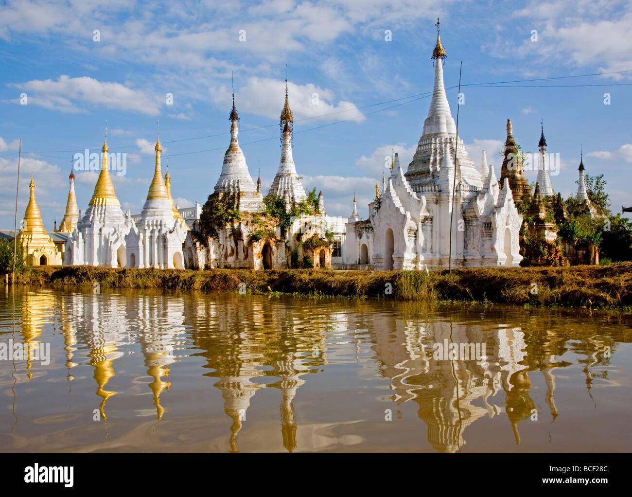 Myanmar, Burma, Lake Inle. Buddhist shrines reflected in the waters of Lake Inle. - Stock Image