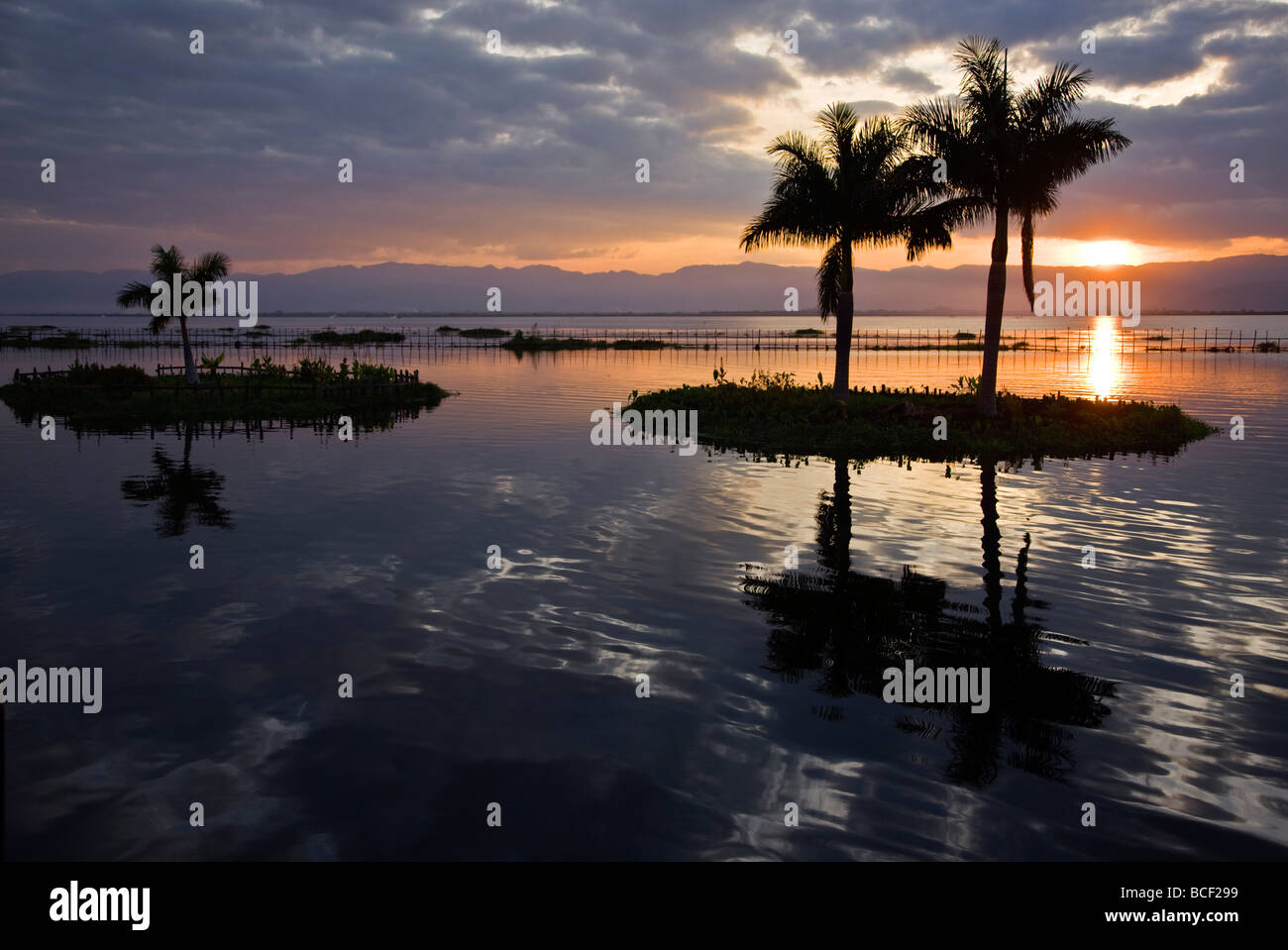 Myanmar, Burma, Lake Inle. Sunset over Lake Inle which is picturesquely sheltered by mountains rising to 1,524 metres. - Stock Image