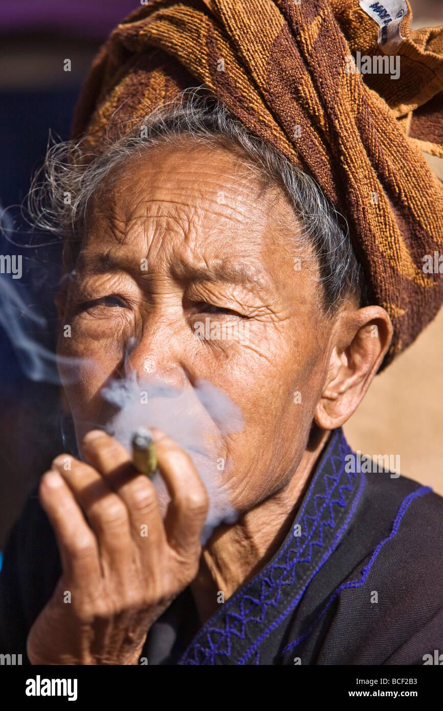 Myanmar, Burma, Lake Inle. An old Pa-O woman smokes a cheroot. - Stock Image