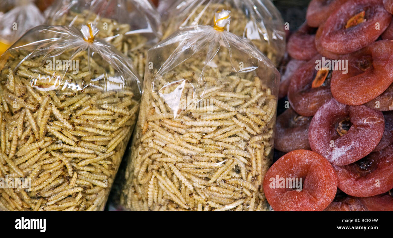 Myanmar, Burma, Kengtung. A stall at Kengtung market offers dried fruit and fried bamboo worms which are palatable - Stock Image