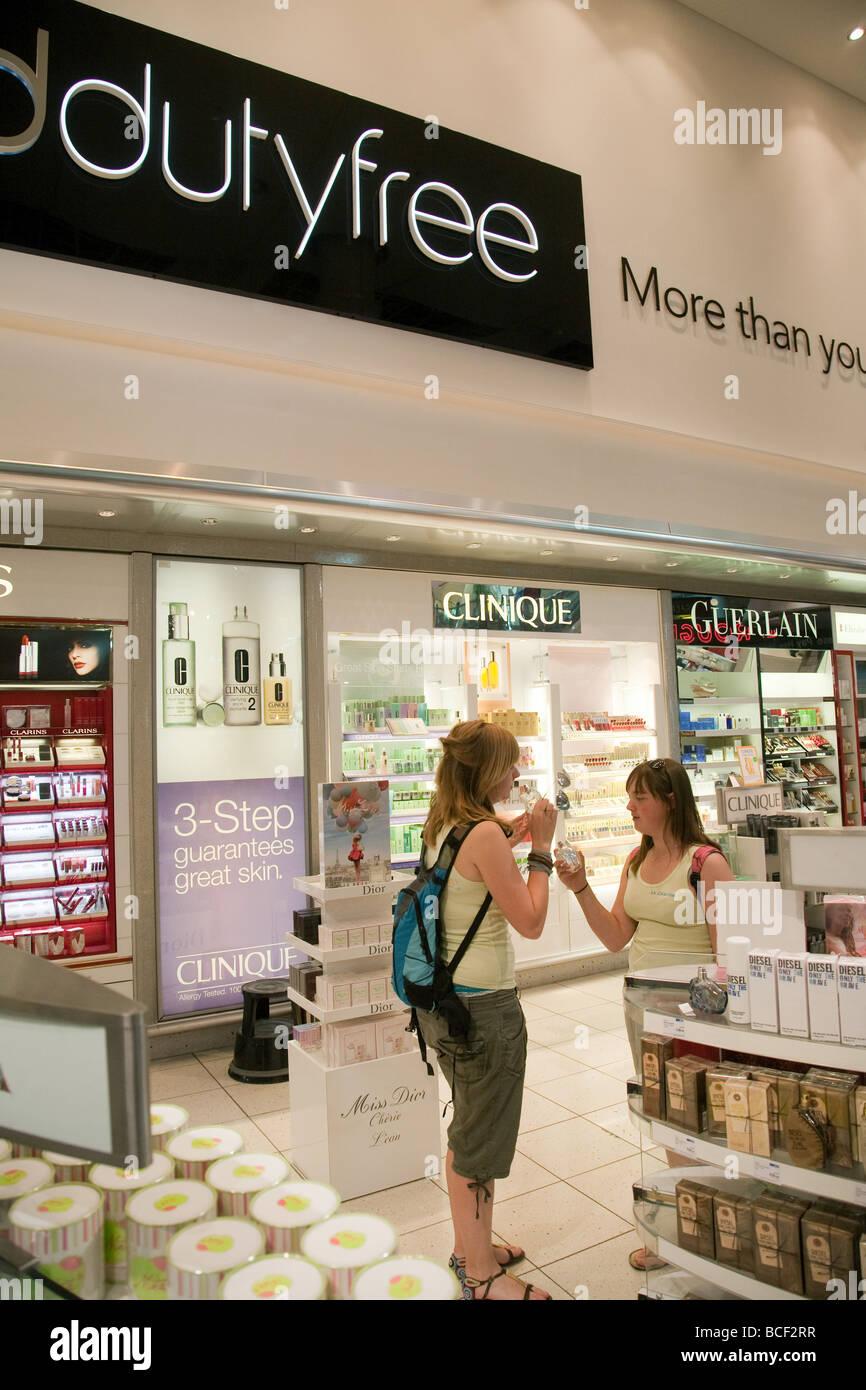 Two girls buying Duty Free perfume, Departure Lounge, North terminal Gatwick airport, UK - Stock Image