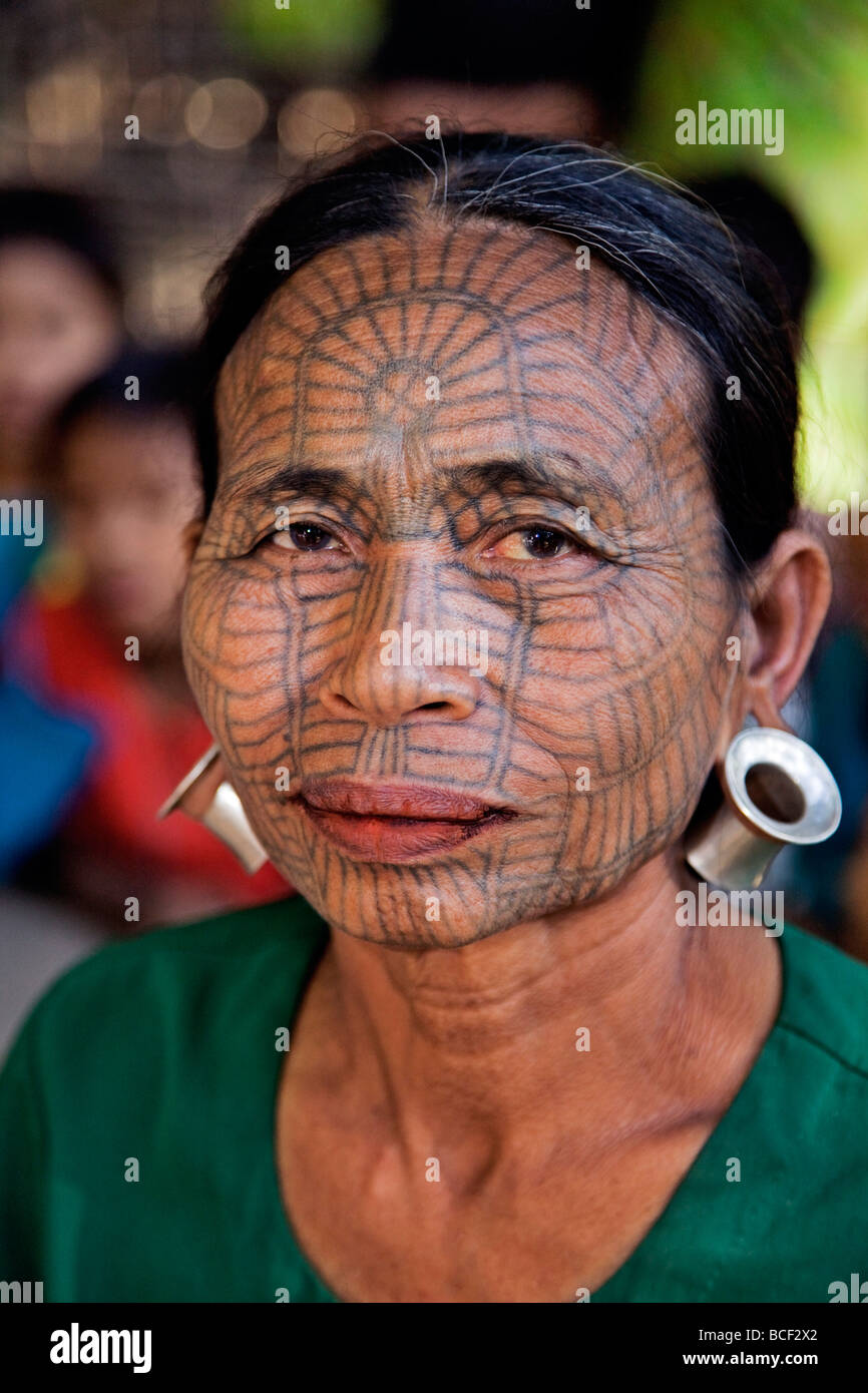 Myanmar, Chin State, Panbaung Village. A Chin woman with tattooed face. It was customary for girls to be tattooed - Stock Image