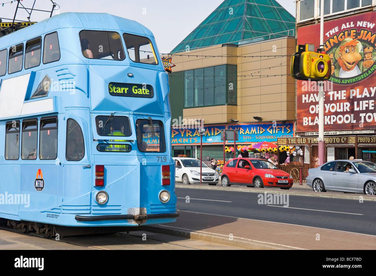 Electric tram travelling along Blackpools golden mile Lancashire England UK United Kingdom GB Great Britain - Stock Image