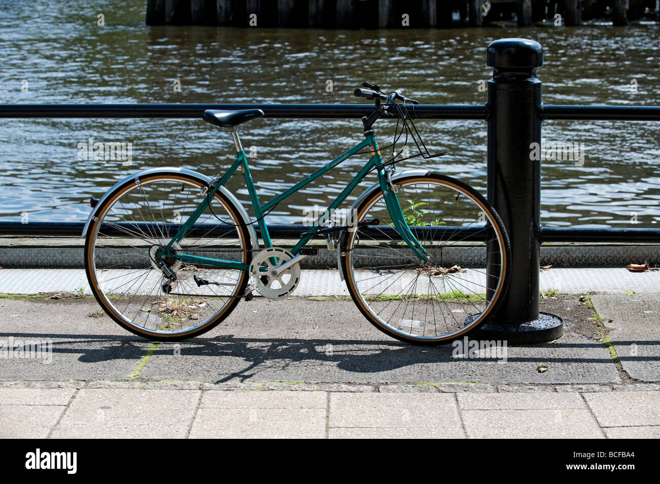 Bicycle chained to railing on Quayside, Newcastle-upon-Tyne - Stock Image