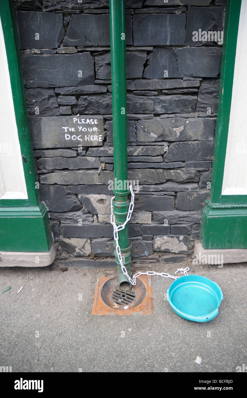 Drainpipe with invitation to tie up your dog, Coniston, Cumbria, UK - Stock Image