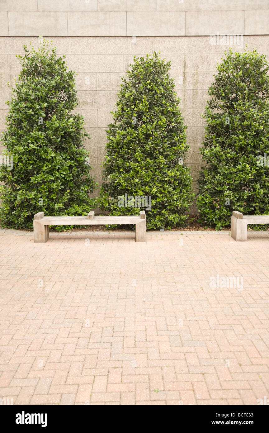 New street furniture sits next to a new developement on the south side of the Thames by Battersea power station. - Stock Image