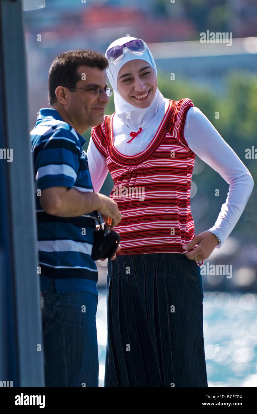 Turkey , Istanbul , Kabatas , Bosphorous or Bogazi , happy young Syrian couple , honeymooners ,  on boat trip , Stock Photo