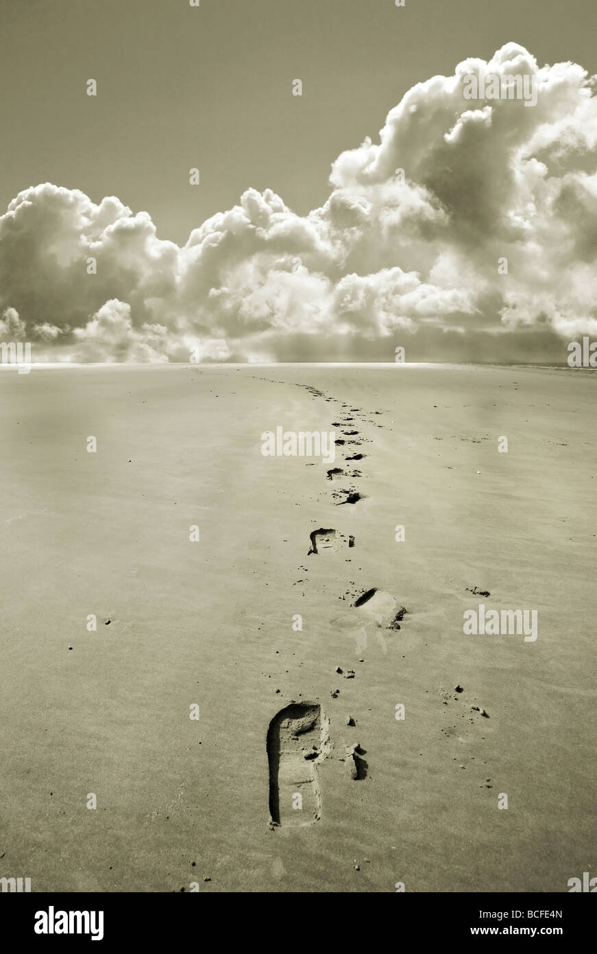 footprints disappear off to the the distant horizon of just clouds Stock  Photo - Alamy