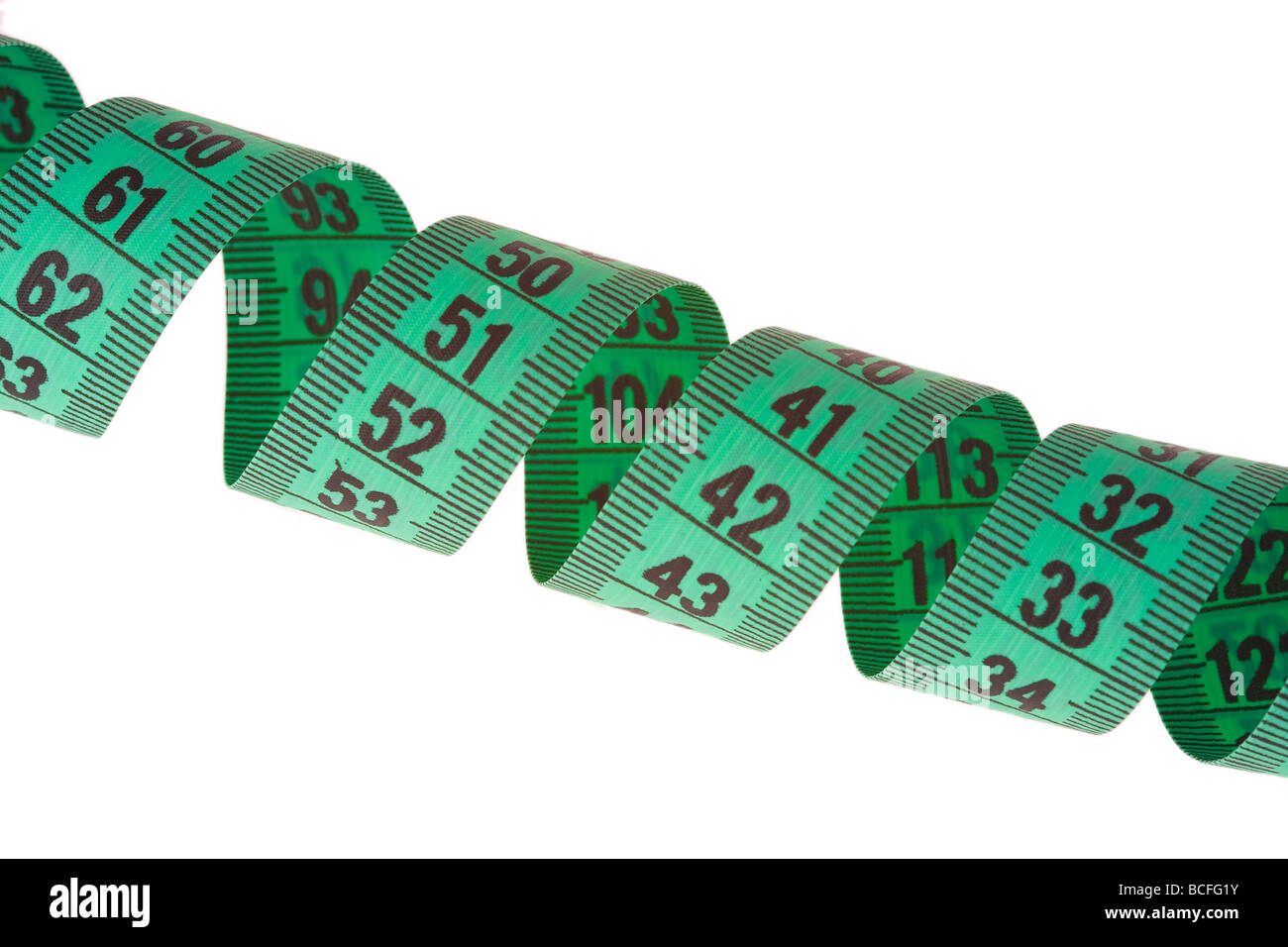 green measuring tape on white background - Stock Image