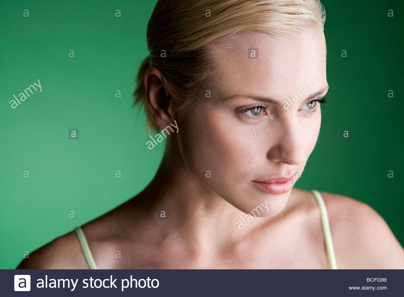 A portrait of a young blonde woman thinking - Stock Image