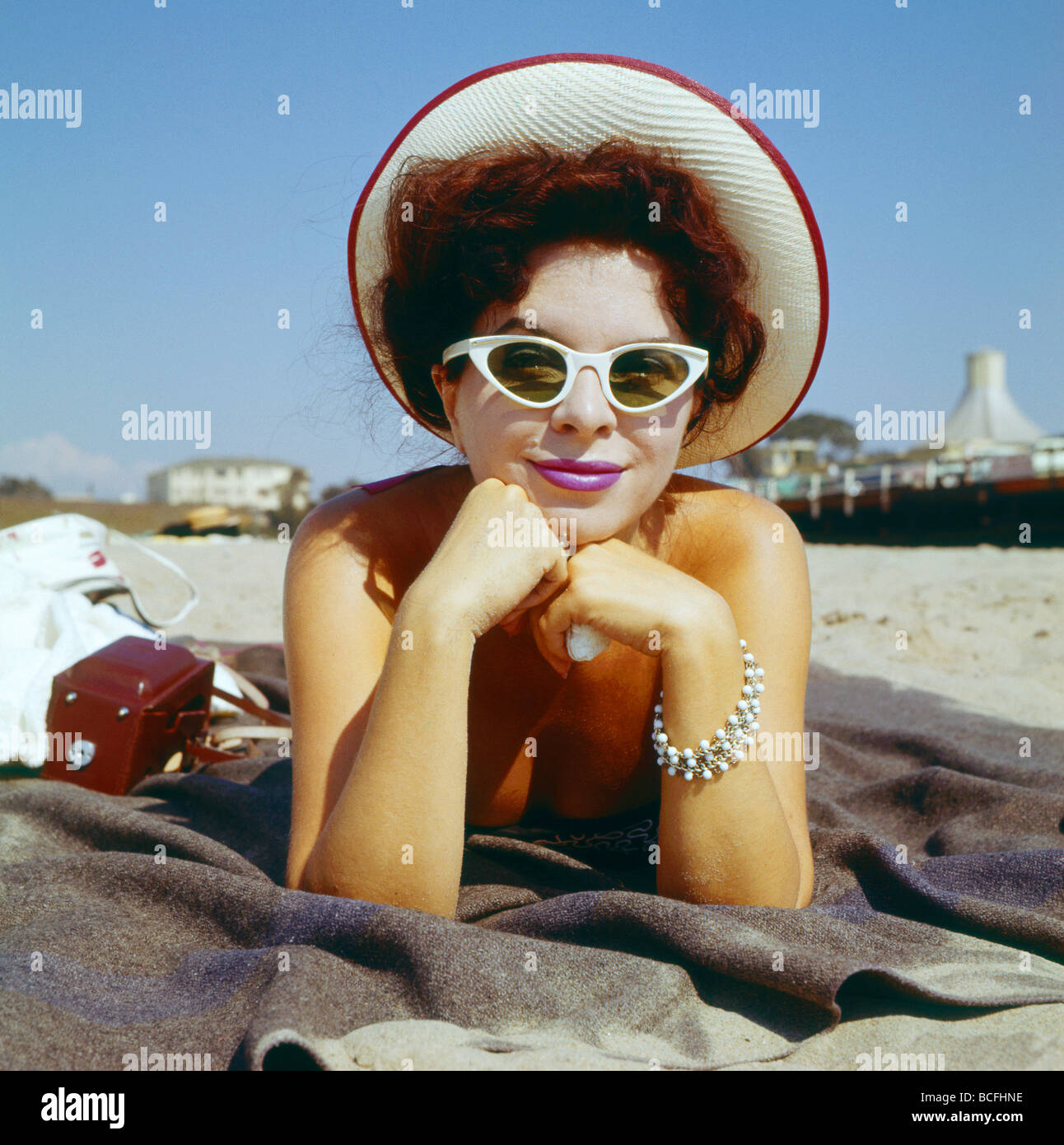 Actress Doris Riter, who appeared in the 1957 film, 'Until they Sail,' poses for a photo on the beach in - Stock Image