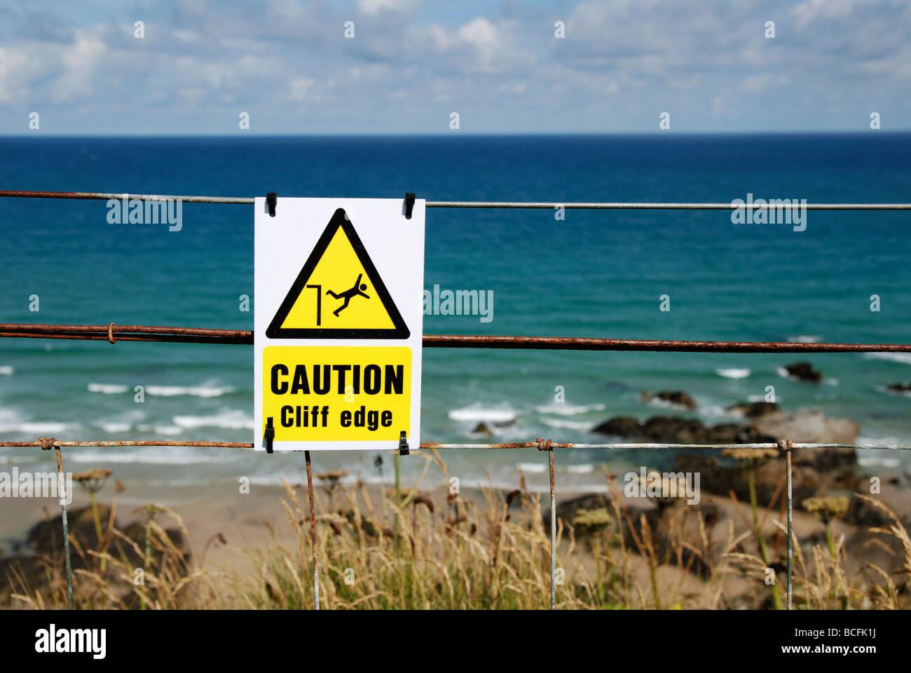 a warning sign above the coastal cliffs at newquay,cornwall,uk - Stock Image