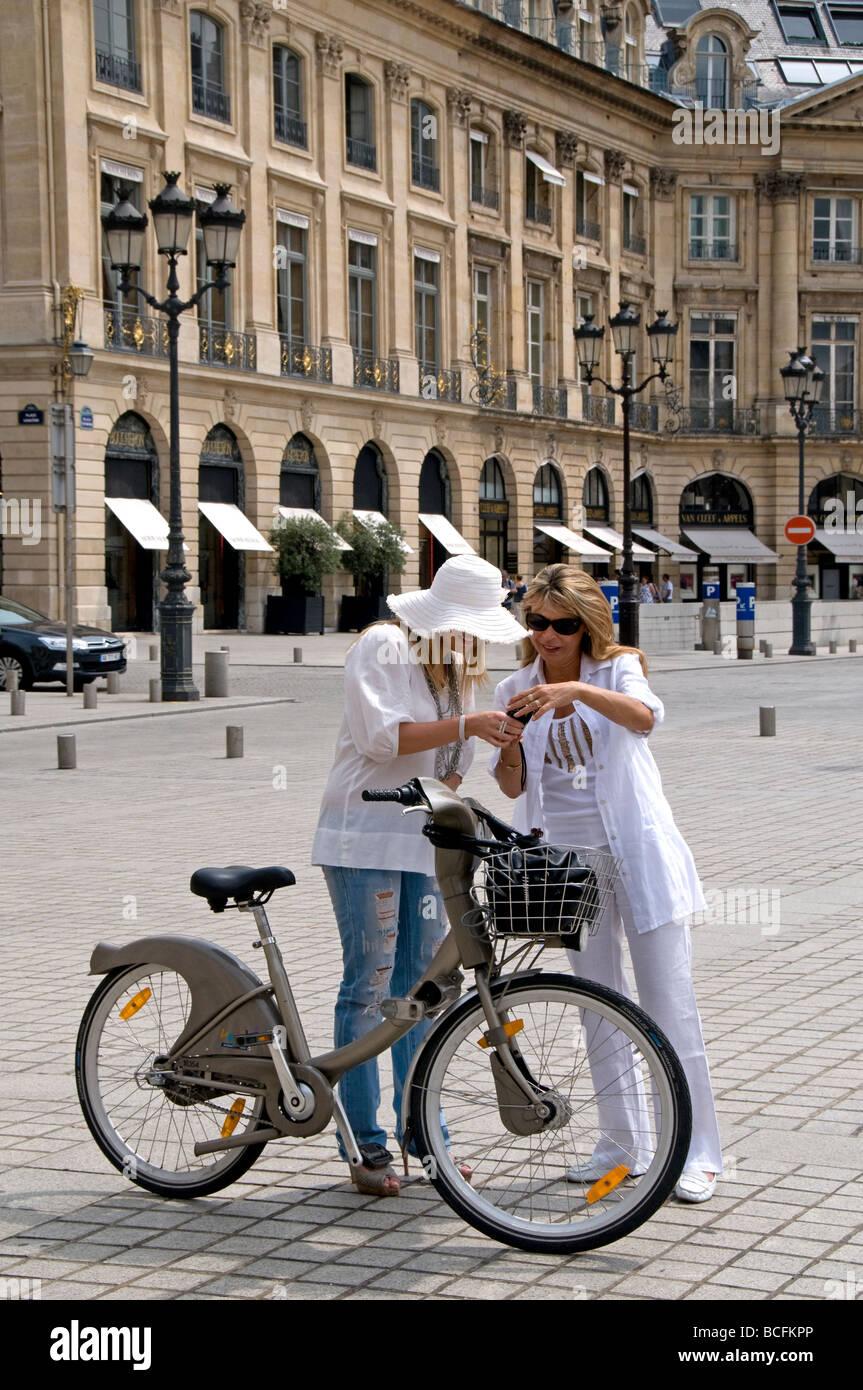 Place Vendome Paris France woman women fashion bicycle cycle bike - Stock Image
