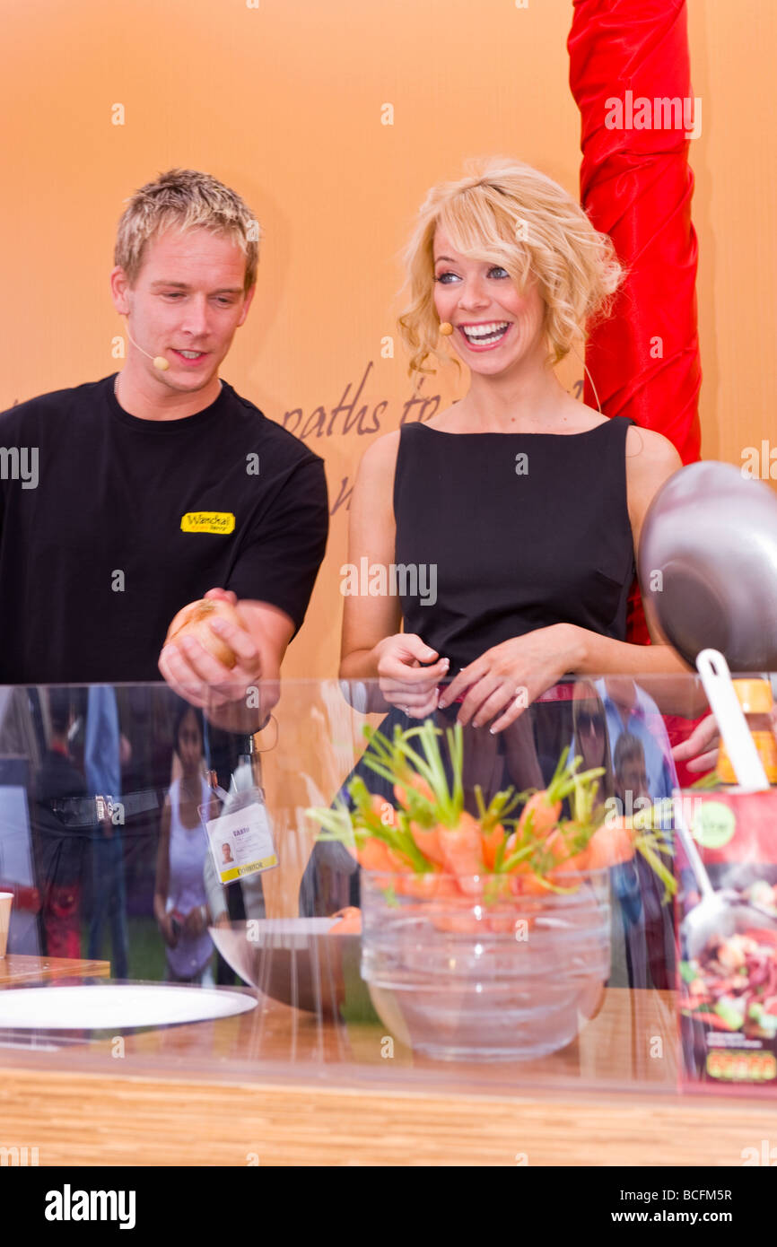 Taste of London , celebrity master chef , beautiful smiling Liz McClarnon helps out on the Wachai Ferry Chinese - Stock Image