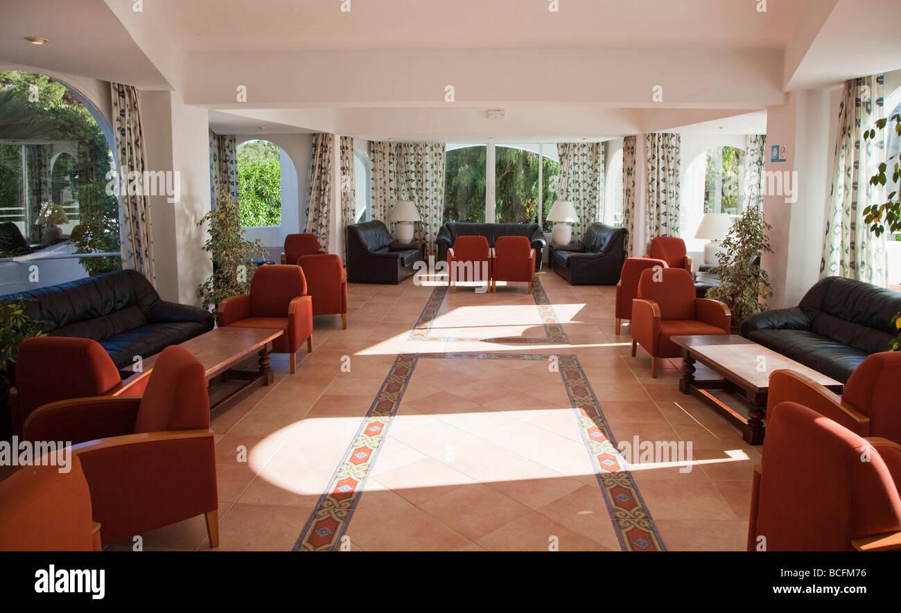 Light shining through windows of hotel lounge Costa del Sur Cala d'Or Mallorca Spain - Stock Image