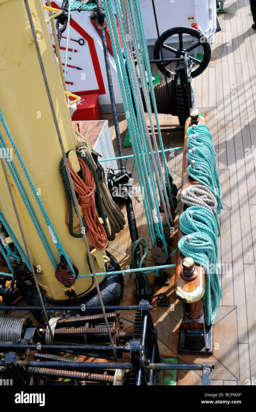 Looking down at ships deck with rigging lines from sails and winches - Stock Image