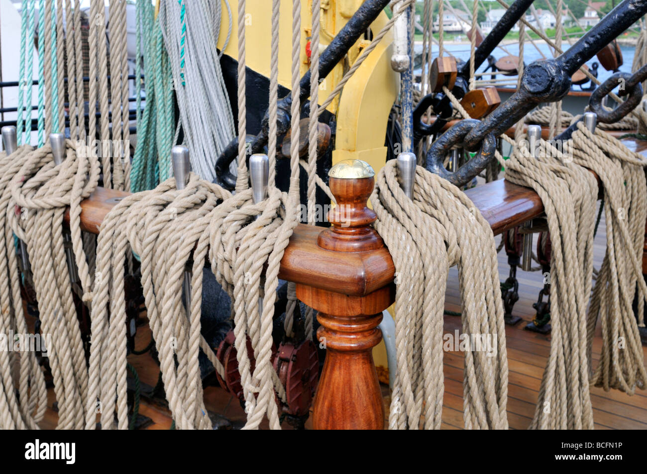Sailing tall ships rigging lines coiled on posts - Stock Image