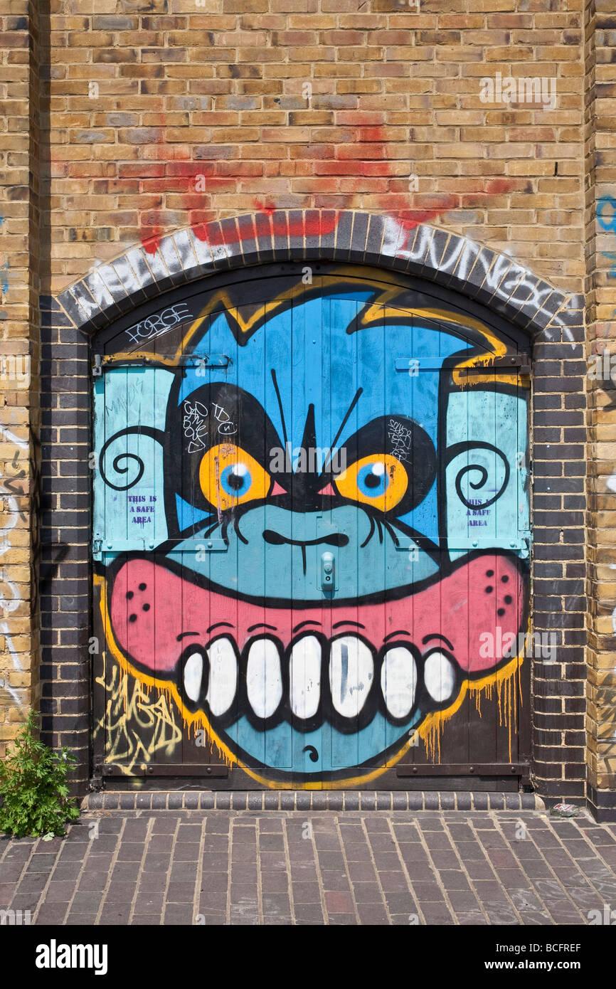 Monkey face graffiti. Hackney, East London, England, UK - Stock Image