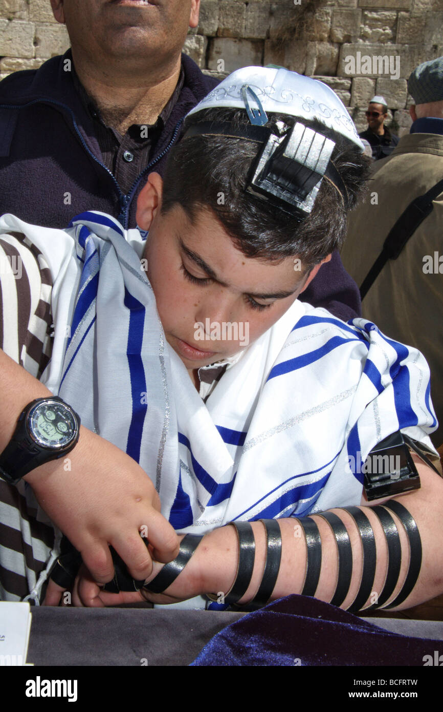 Israel Old City of Jerusalem Bar Mitzvah ceremony A young boy of 13 laying Tefillin at the Wailing Wall - Stock Image