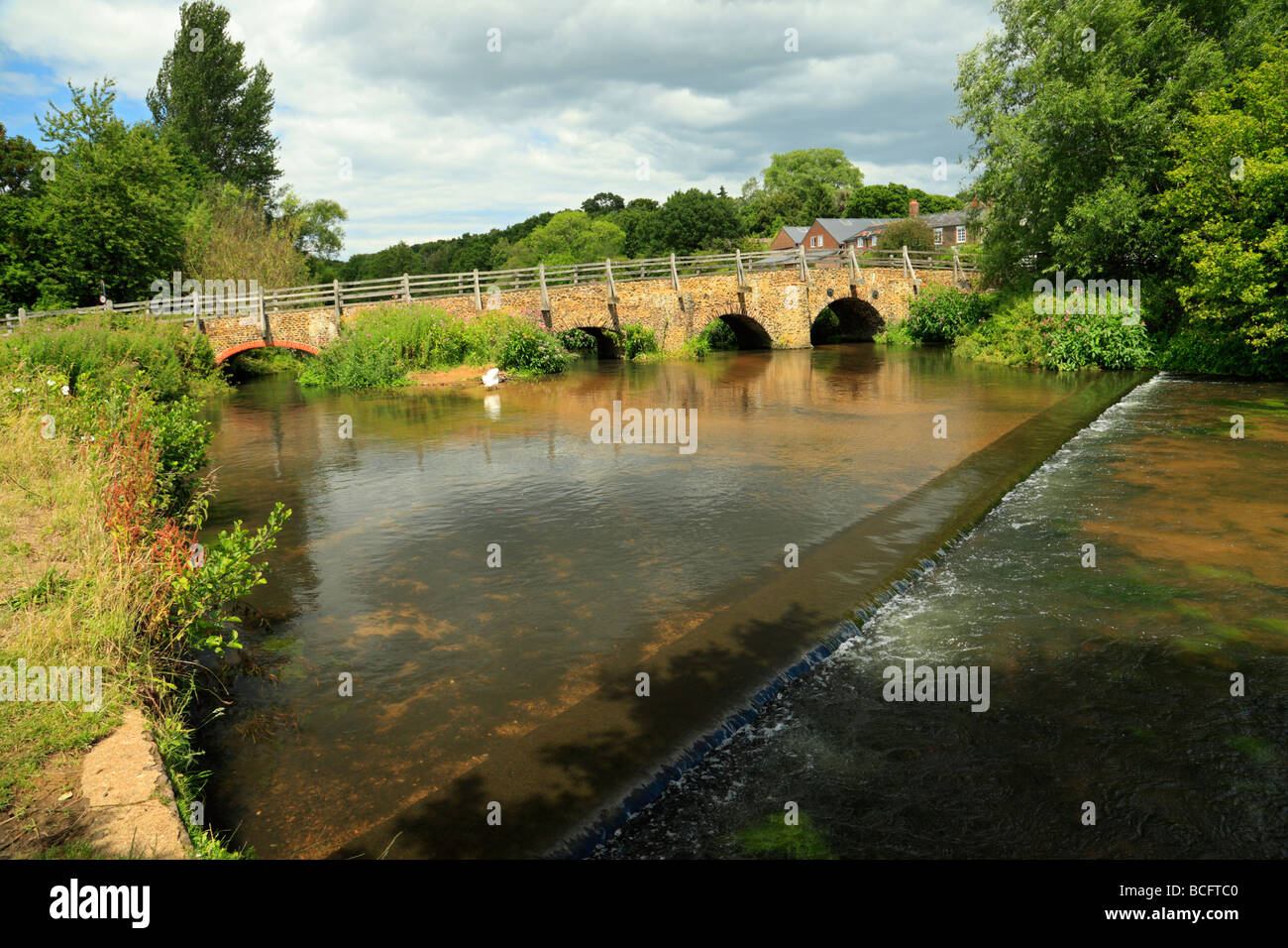 Tilford East Bridge. Crossing the river Wey, Surrey, England, UK. - Stock Image