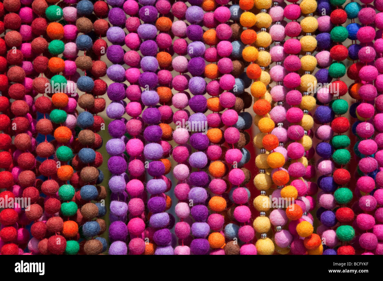 Colourful fabric bead necklaces on sale in market Sineu Mallorca Spain - Stock Image