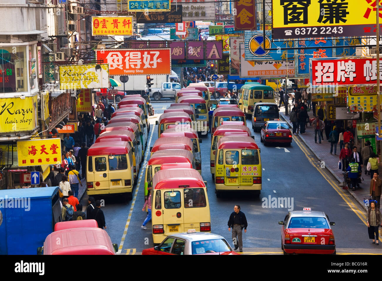 Buses nr Fa Yuen St Market Hong Kong China - Stock Image