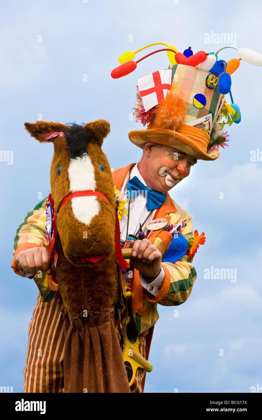 Stilt man on wheeled horse Frampton On Severn Gloucestershire UK - Stock Image