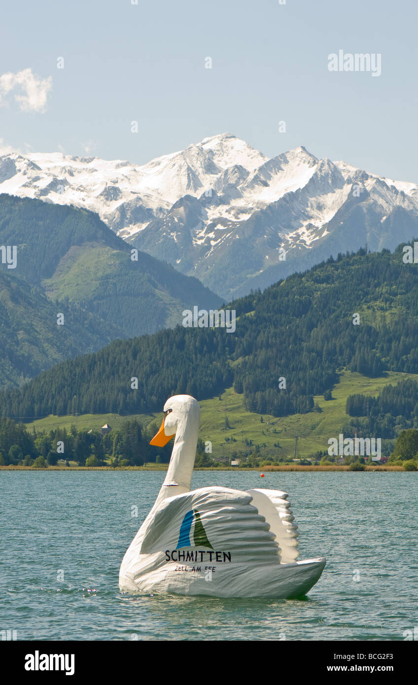 A large man made swan promoting Schmitten ski resort on the lake at Zell am See in Austria. Stock Photo