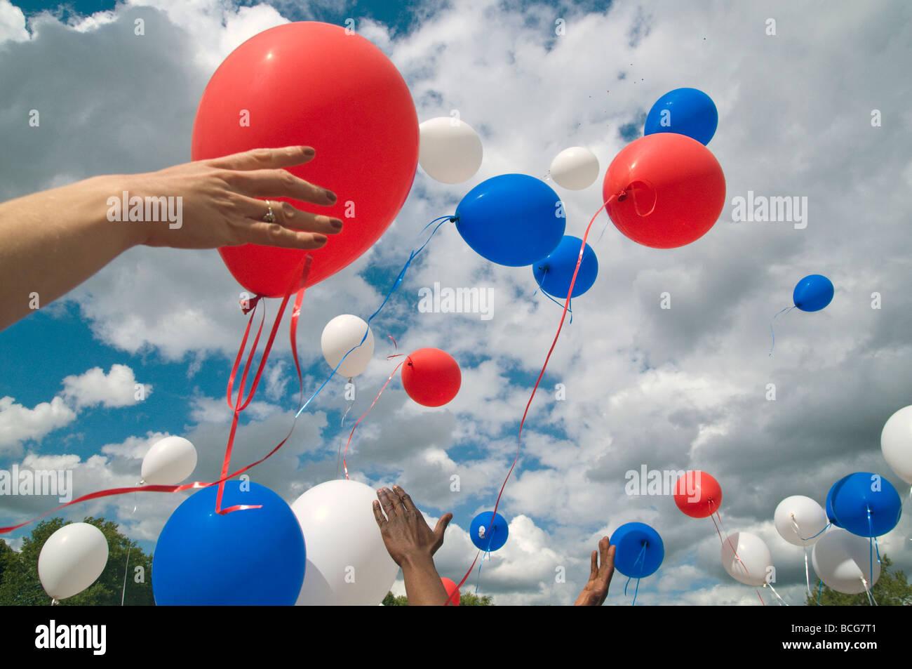 France. Tricolour balloons at Bastille Day festival, Paris.Photo © Julio Etchart - Stock Image