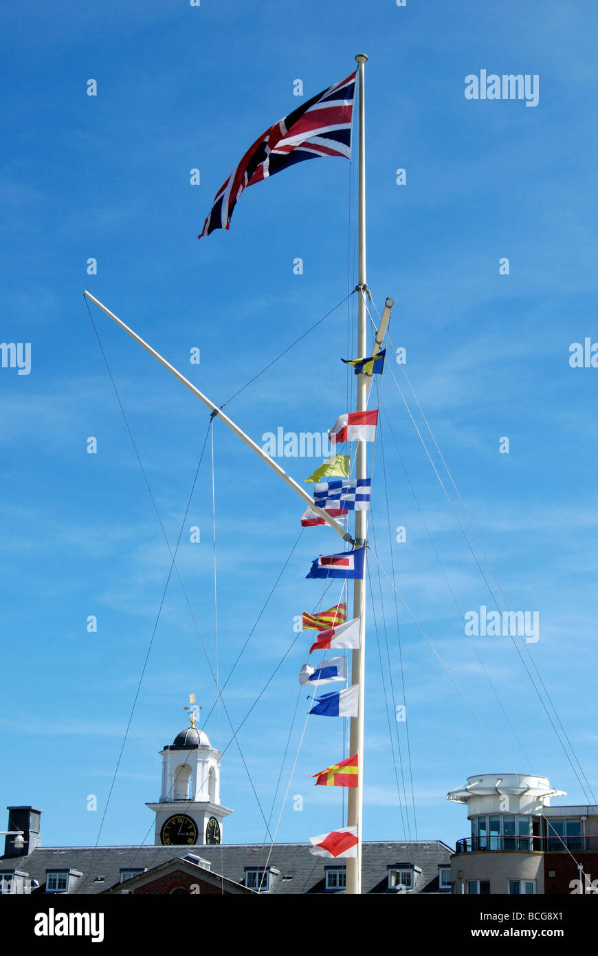 Various flags on flagpole at Gunwharf Quays Porstmouth Hampshire England Stock Photo