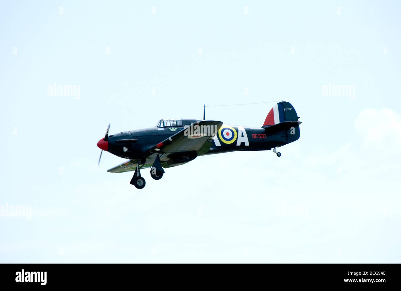 A model Hurricane in flight at an airshow in France - Stock Image