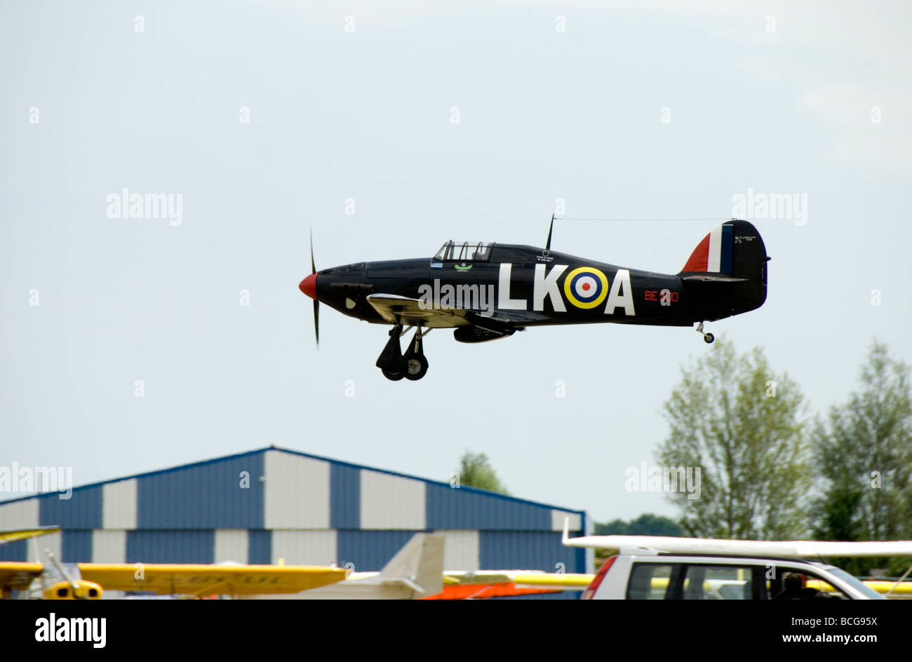 A model Hurricane coming in to land at an airshow in France - Stock Image
