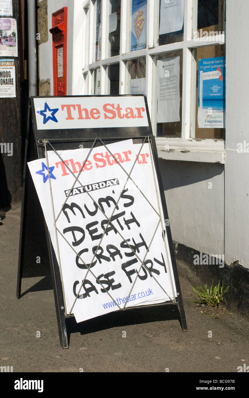 Newspaper headline board outside a newsagents shop in England - Stock Image