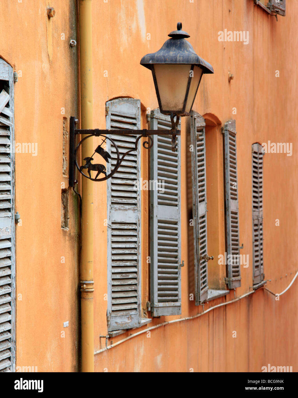 Street Lamp and Shuttered Windows Grasse Provence France - Stock Image