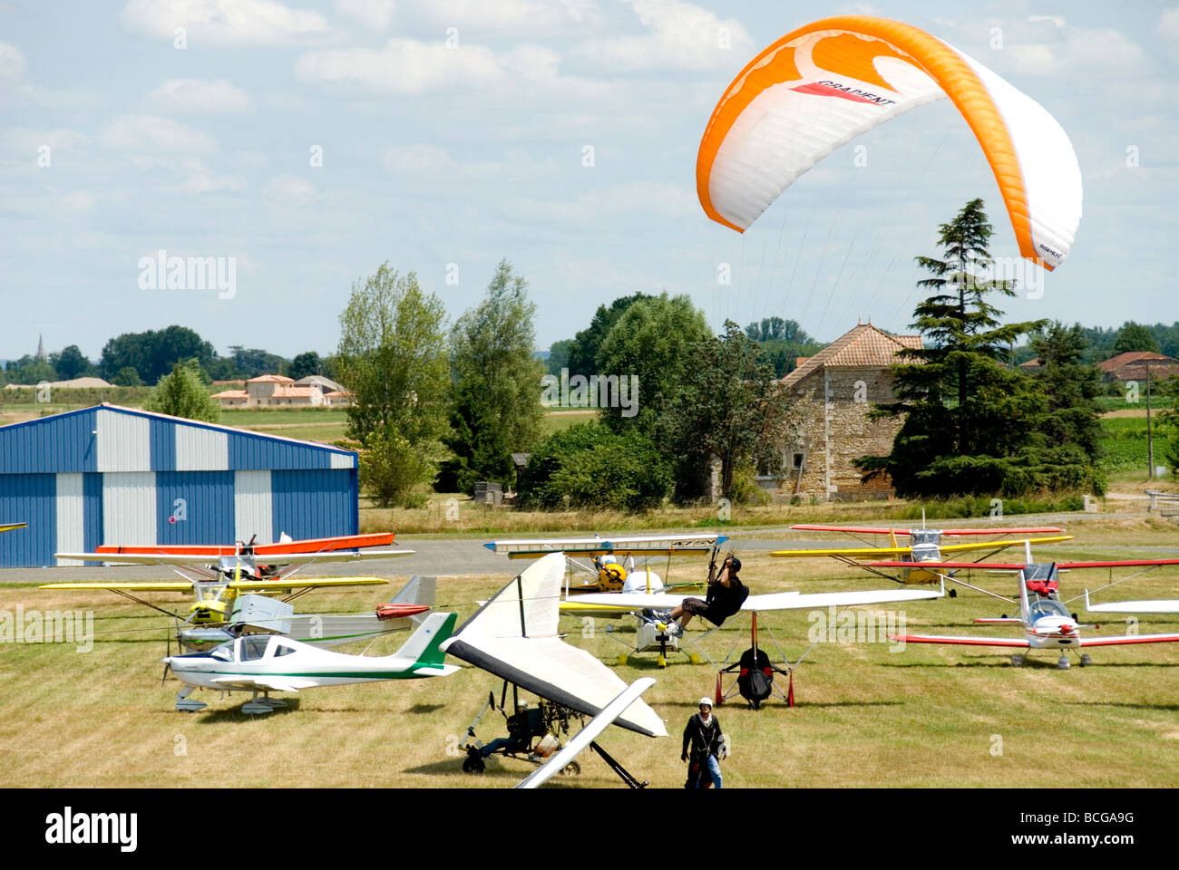 Paraglider coming in to land at an airshow in France Stock Photo