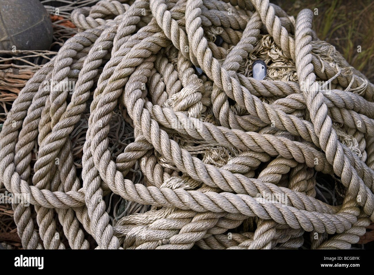 A pile of nylon rope or line used to tie ships to their mooring or dock. - Stock Image