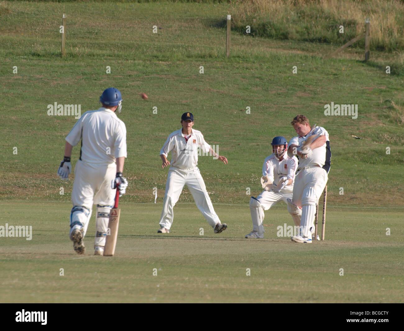 Batsman slogging the ball Amateur cricket match Bude Cornwall - Stock Image