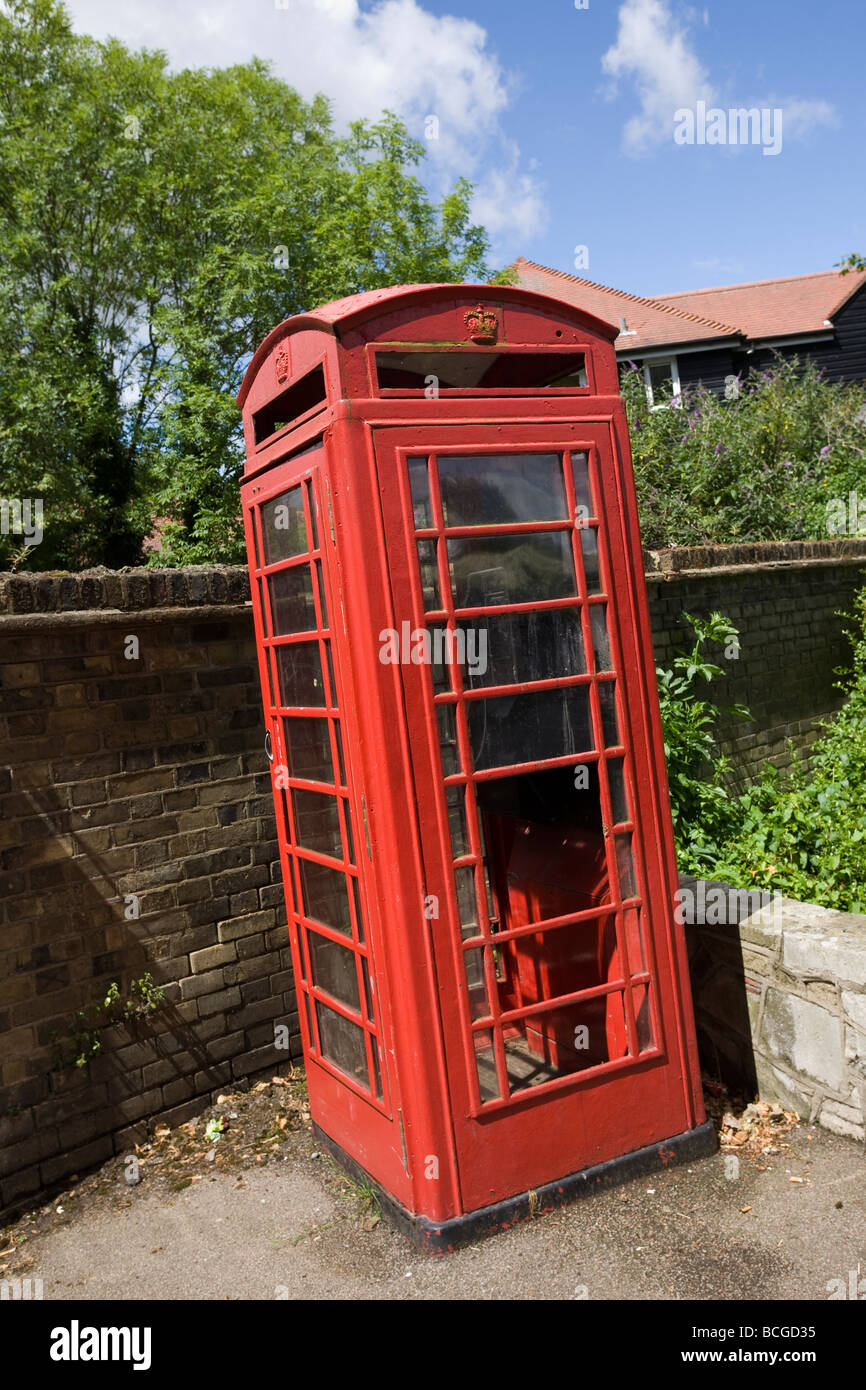Listed red telephone kiosk in Waltham Abbey Essex - vandalised - Stock Image