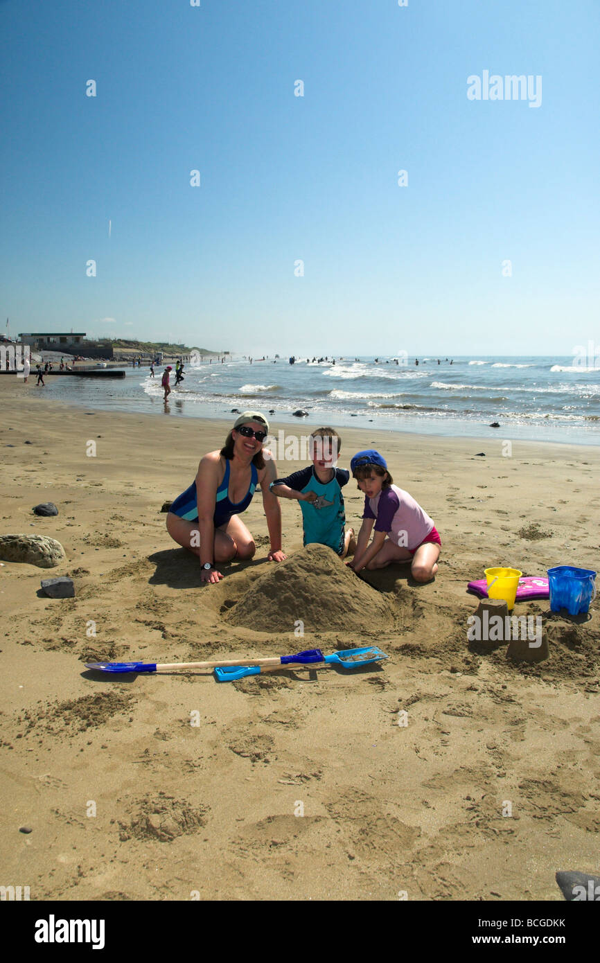 Family on Holiday on Pendine Beach Wales UK - Stock Image