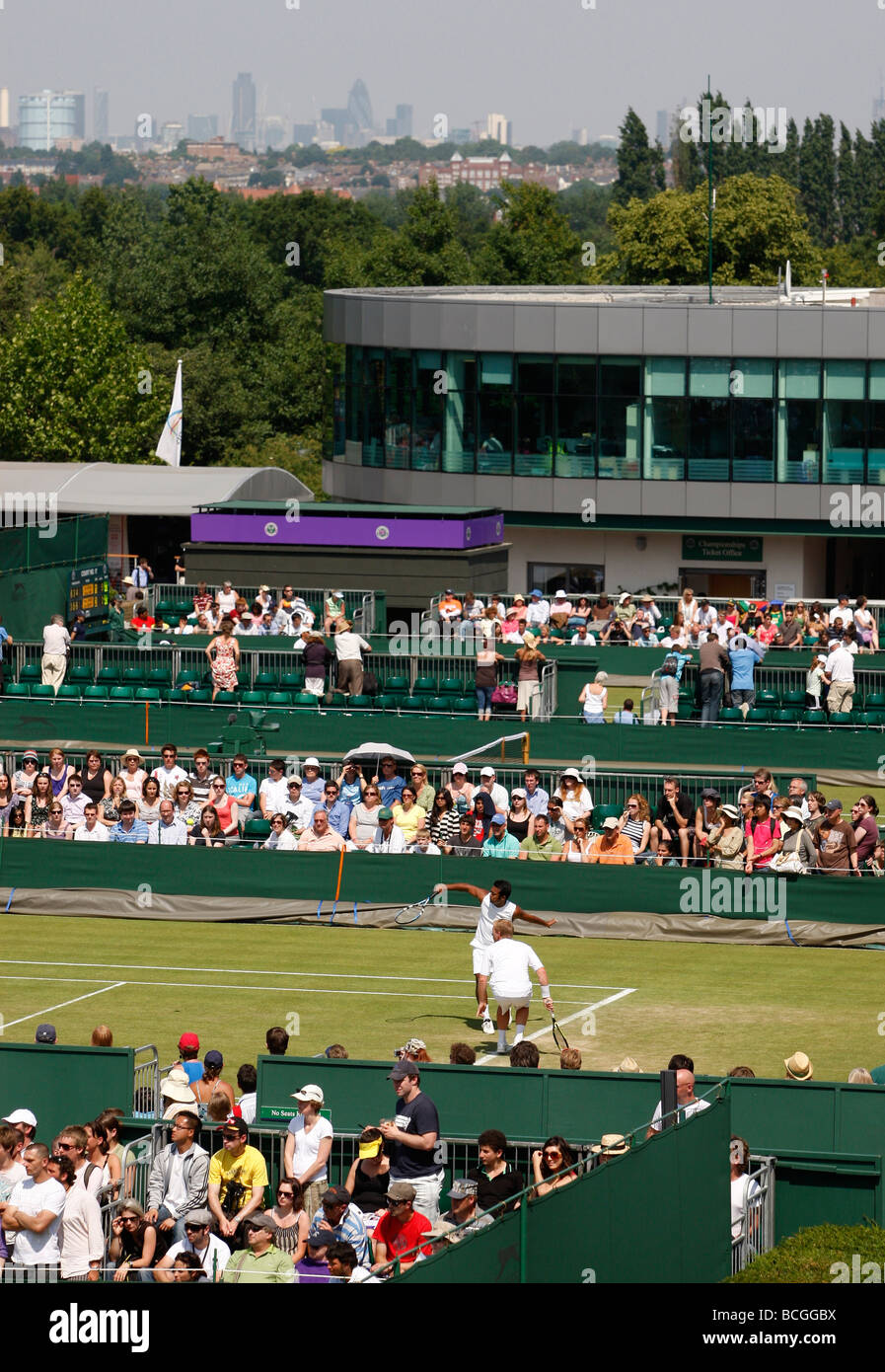 View of the Wimbledon tennis courts with the London skyline in the background - Stock Image