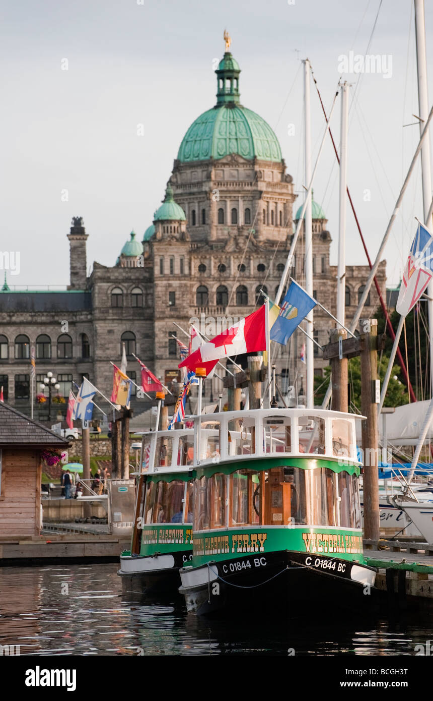 Victoria, British Columbia. Small ferry boats shuttle tourists around the inner harbor to hotels and various attractions. Stock Photo