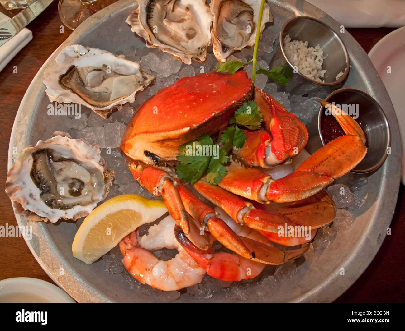 Fishplate Crab and oyster at Sand Bar on Granville Island Vancouver British Columbia Canada North America - Stock Image