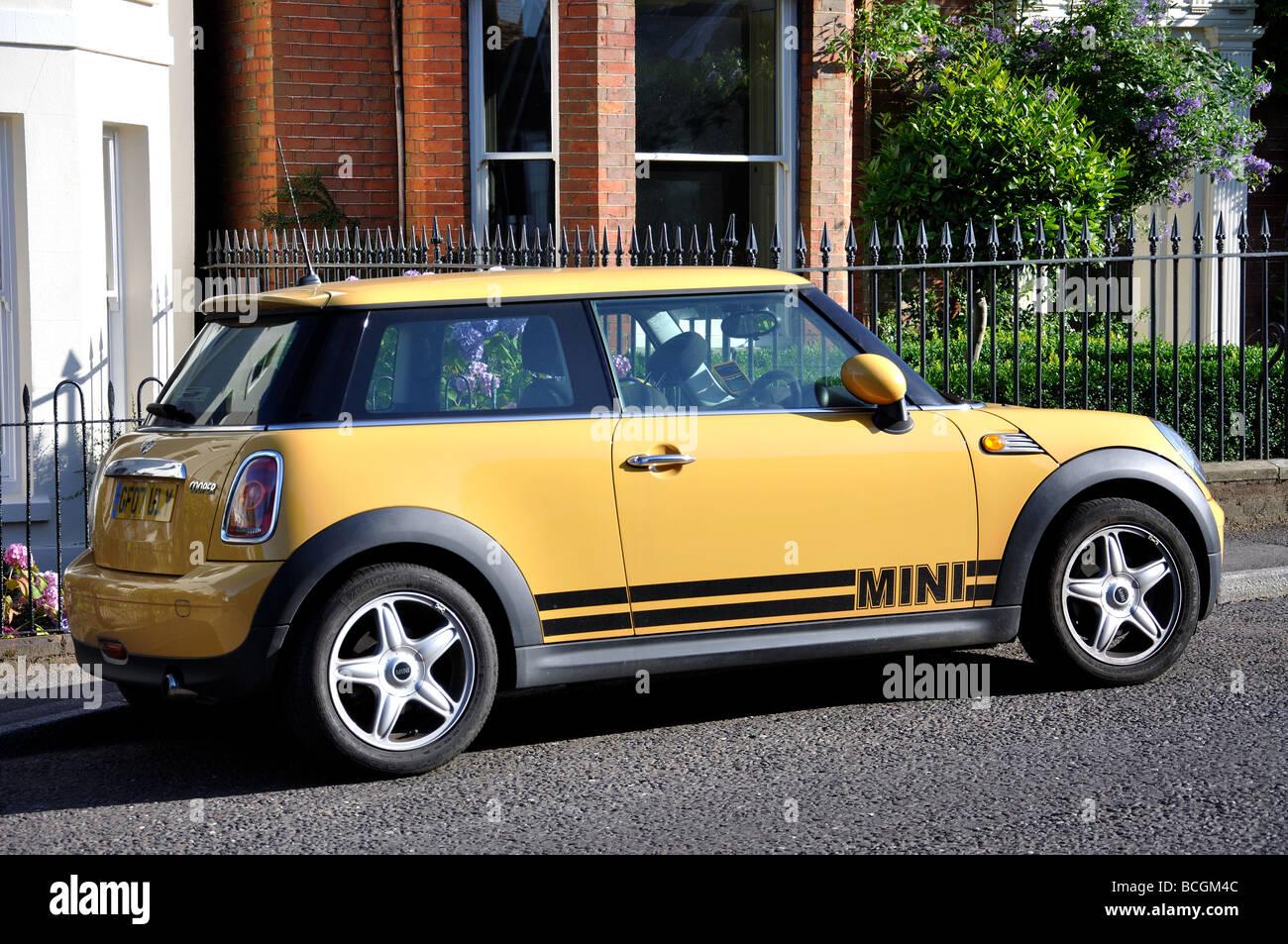 Yellow BMW Mini Cooper, High Street, Cranbrook, Kent, England, United Kingdom - Stock Image