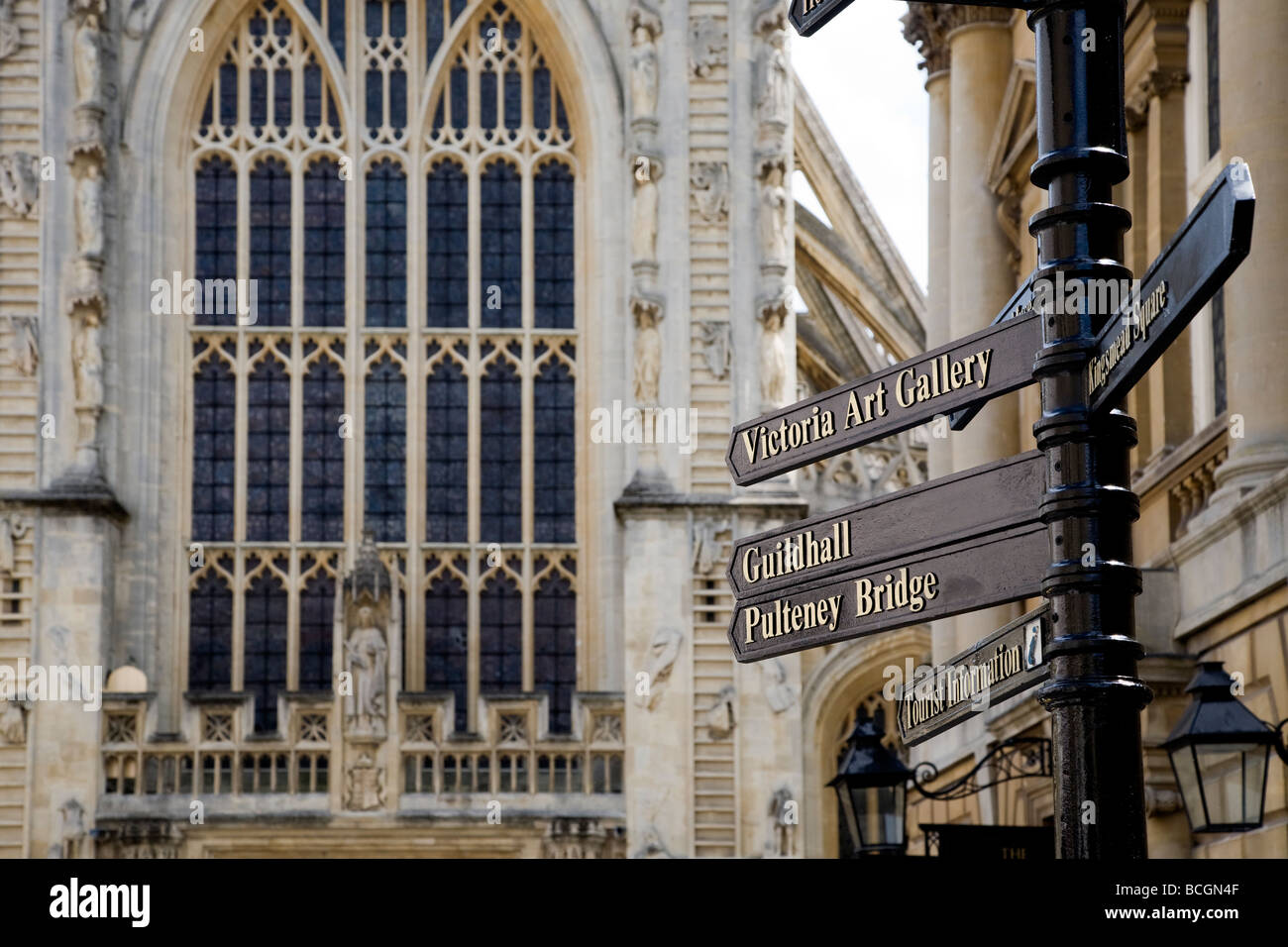 A VIEW OF THE ABBEY CHURCHYARD AREA WITH SIGNPOST GIVING DIRECTIONS TO THE POPULAR ATTRACTIONS - Stock Image