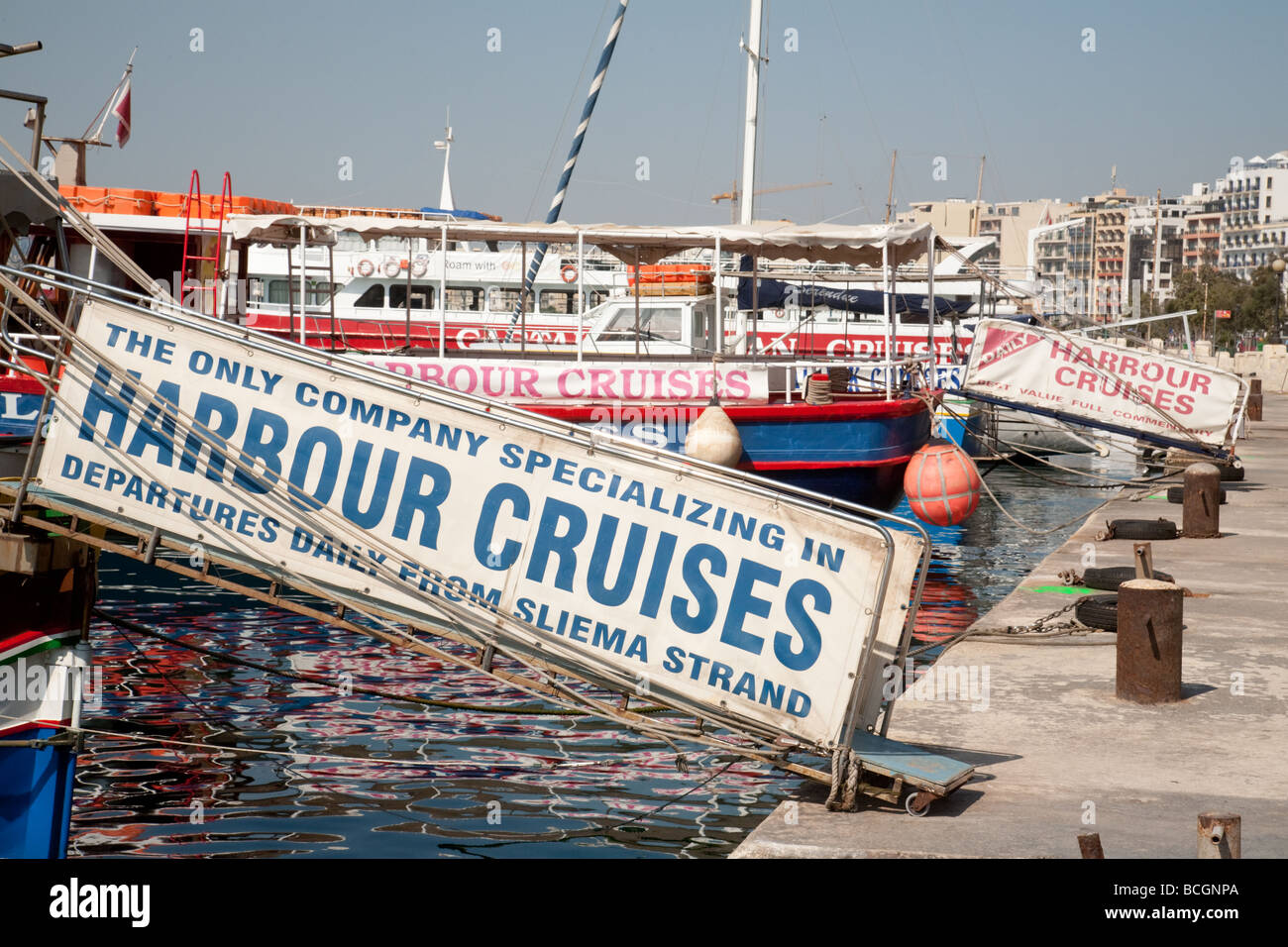 Signs and adverts for cruises, The seafront, Sliema, Malta - Stock Image