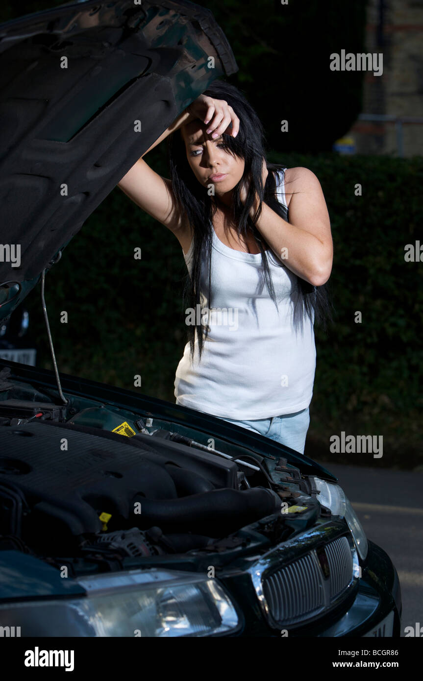 young adult / teen by car that has broken down Stock Photo