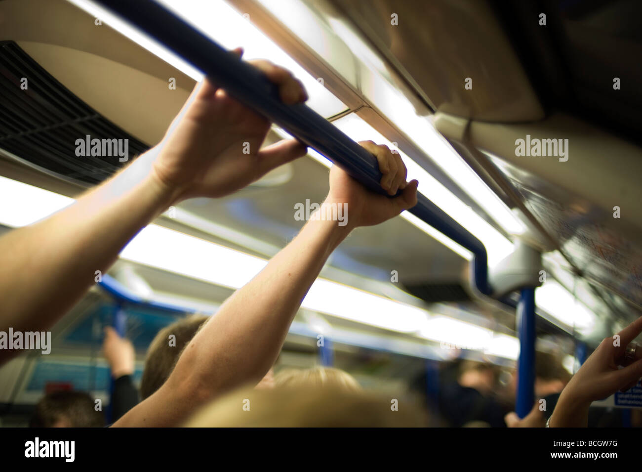 London underground tube comute crush overcrowded travel piccadilly line hot sweat straphanging bodies smell touch - Stock Image