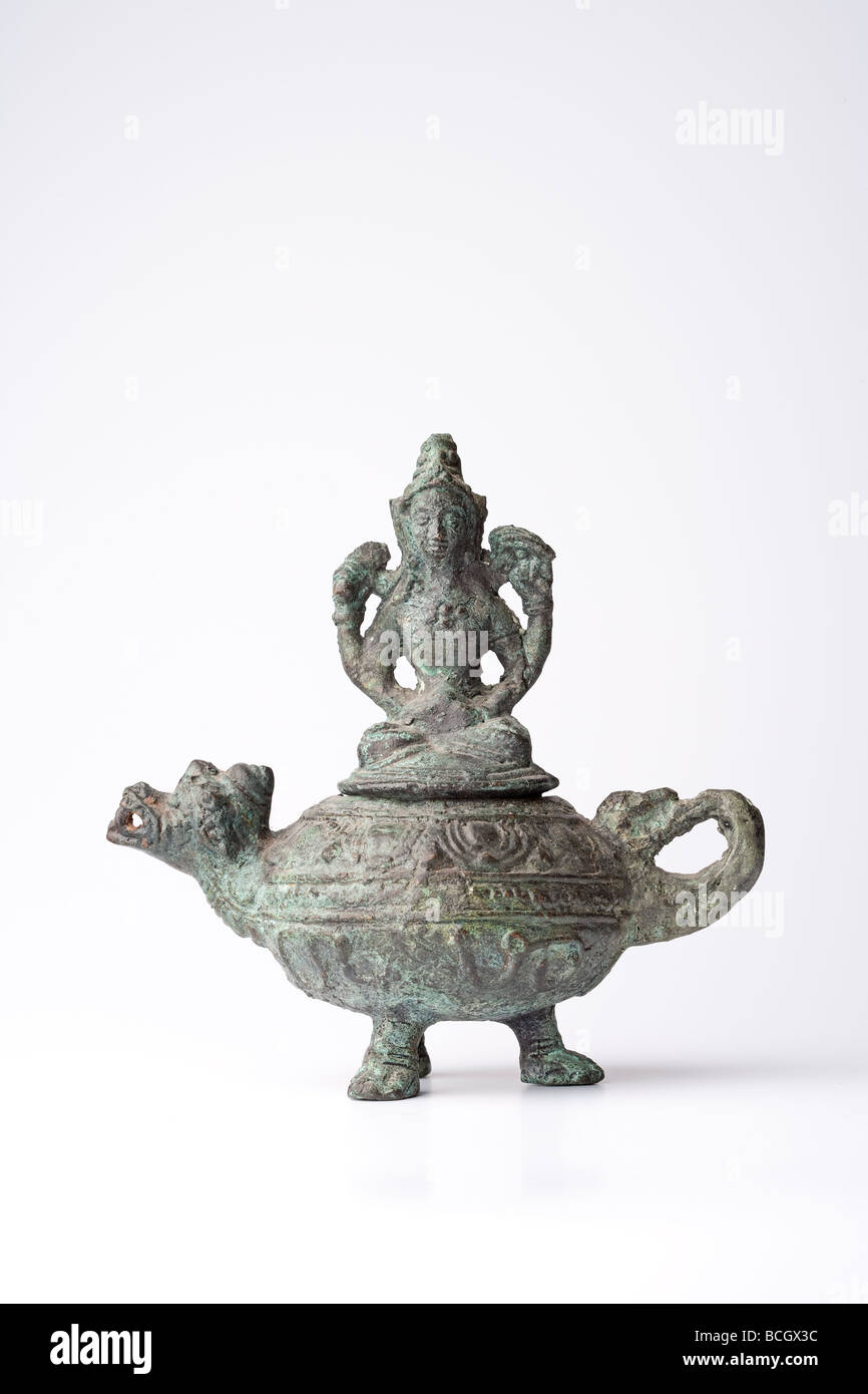 Souvenir from Indonesia, bronze oil lamp - Stock Image