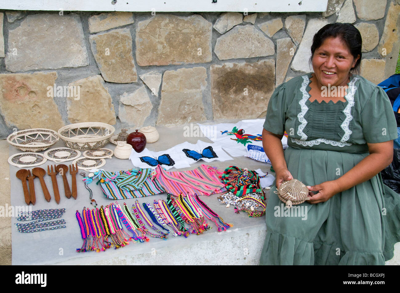 A local Mayan Indian sets out handicraft at the pre-Columbian ruins of Lubantuun in southern Belize 26 miles from - Stock Image