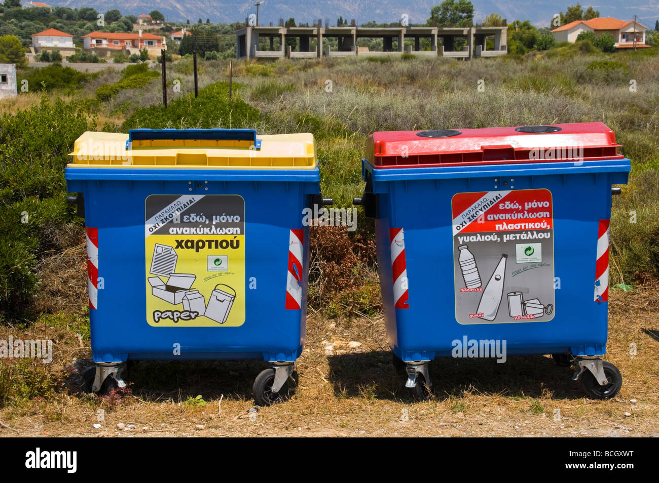 Large recycling bins for paper plastic and metal at Ammes beach on the Greek island of Kefalonia Greece GR Stock Photo